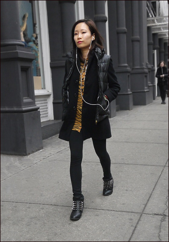 w black leggins silver studded ankle boots tiger stripped shirt dress black coat black pillow vest ol l