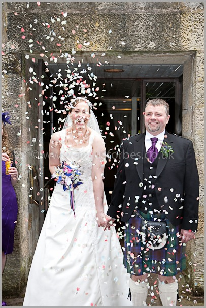 bride and groom covered in confetti