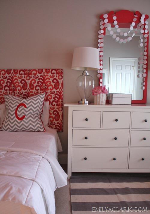 Rug layered over carpet in girls bedroom