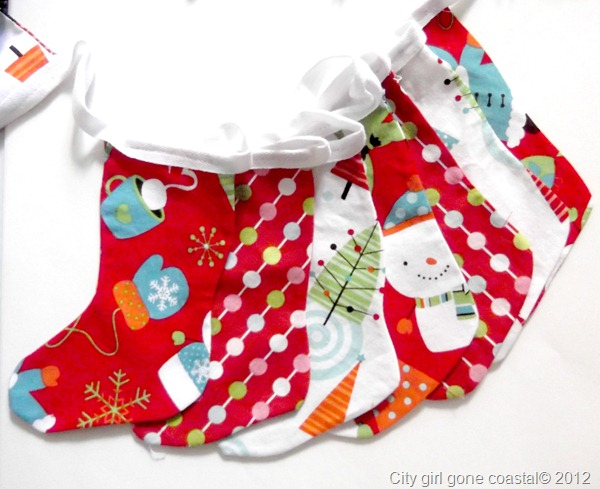 a whole bunch of christmas stockings on bunting tape
