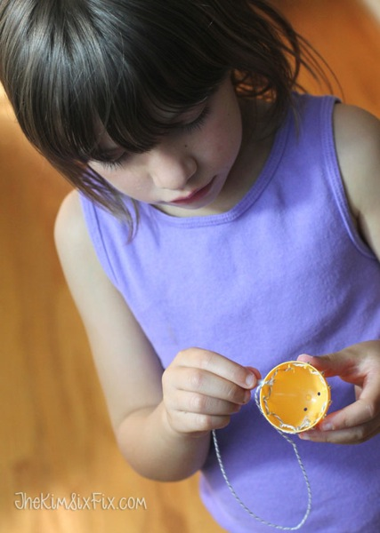 Child sewing easter egg