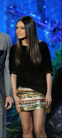 Mila Kunis present an award onstage during the 2011 MTV Movie Awards (converted)