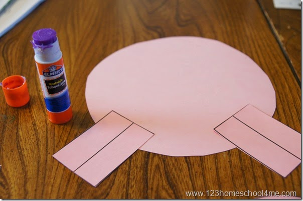 Paste shapes to make a paper pig craft for kids