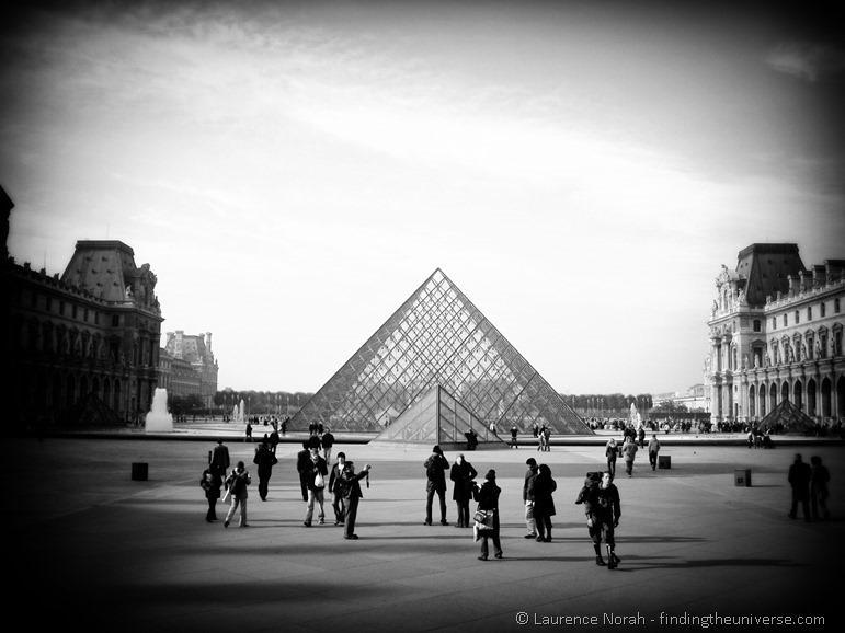 Louvre pyramid and tourists Paris