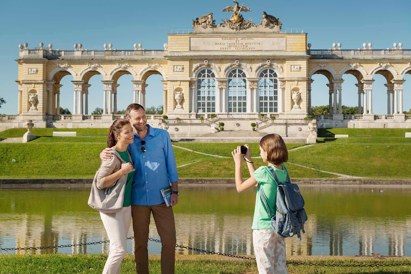 Posing in front of the Gloriette at Schoenbrunn Palace in Vienna. The history of the palace and its vast gardens spans more than three centuries.