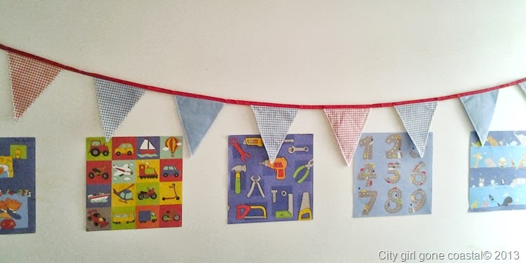 bunting and posters on wall