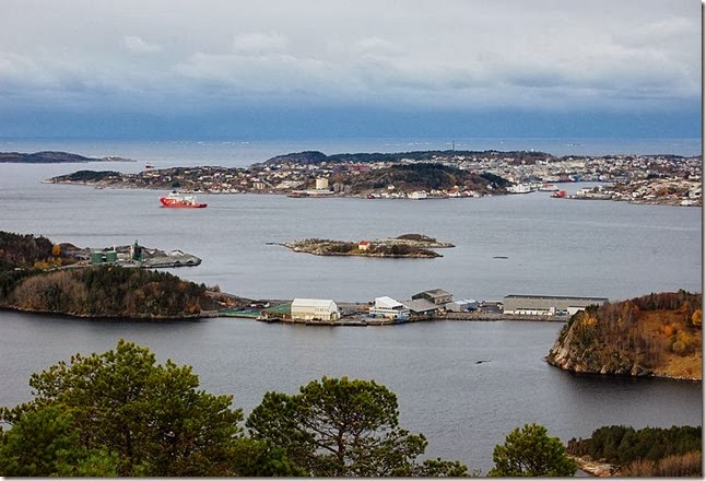 Fugløya in center, parts of Kristiansund city in the background - Wikimedia Commons Harald Oppedal Photographer
