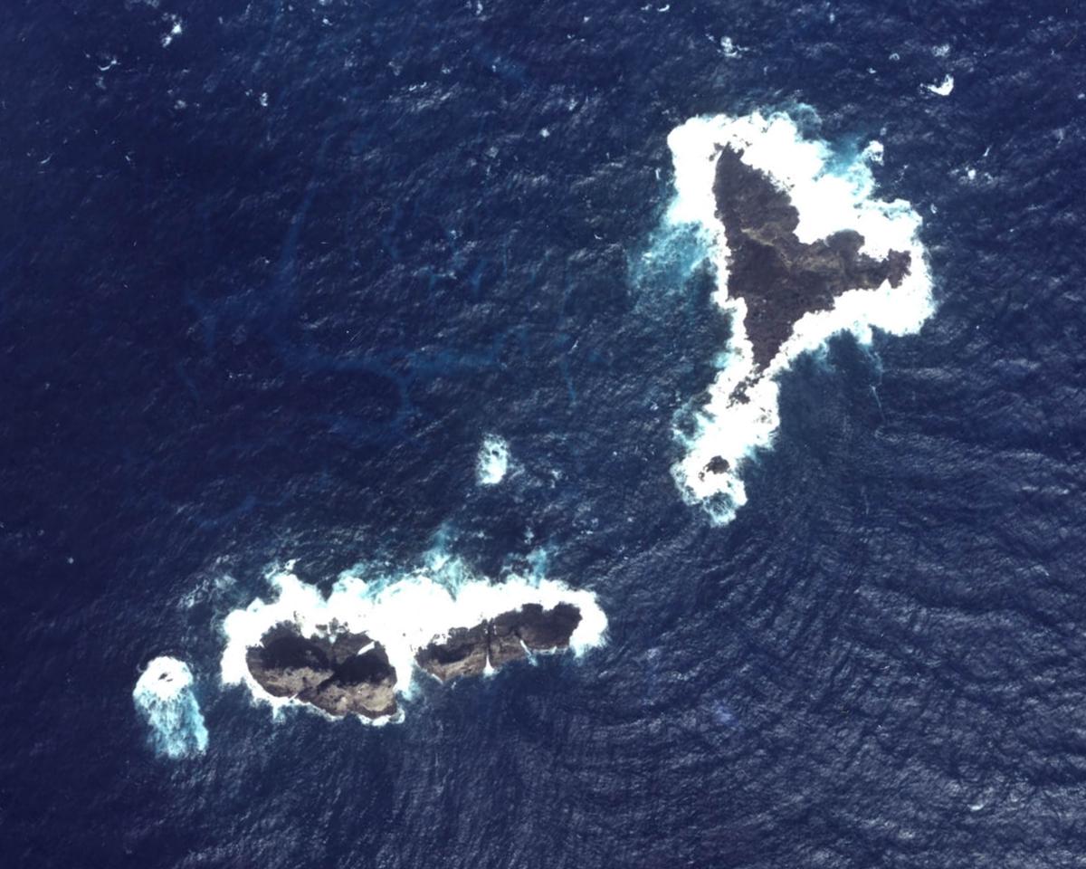 Aerial photo of Oki-no-Kita-iwa (沖の北岩)/Běiyǔ (北屿)/Chōng Běiyán (沖北岩)/Dà Běi Xiǎodǎo (大北小島)/Běiyán (北岩), group of rocks which form part of the Senkaku/Diaoyu Islands disputed between Japan, China, and Taiwan