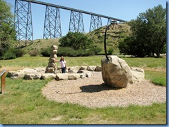 1653 Alberta Lethbridge - Indian Battle Park - rattlesnake sculpture with High Level Bridge in background
