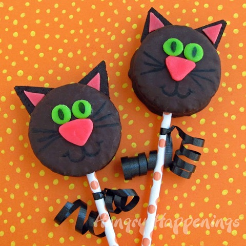 Hostess Ding Dongs Black Cat Cakes for Halloween party treats, Halloween edible crafts, Halloween recipes, black cat cake