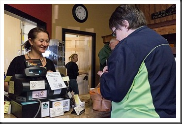 Jennifer serves a customer at Black Dog Coffee