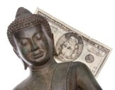 6679908-buddha-with-money-to-represent-the-money-the-religion-makes