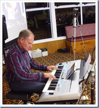 Our special guest artist, teacher and professional musician, Dave Hallam, playing Barbara McNab's Yamaha Tyros 4. Photo courtesy of Dennis Lyons.