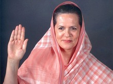 Mrs. Sonia Gandhi, leader of the Ruling Party of India, the Congress party, leader of the ruling coalition of India, United Progressive Alliance [UPA], but not the Prime minister of India. Heads the National Advisory Council [NAC]. Seen here, perhaps, blessing the country.