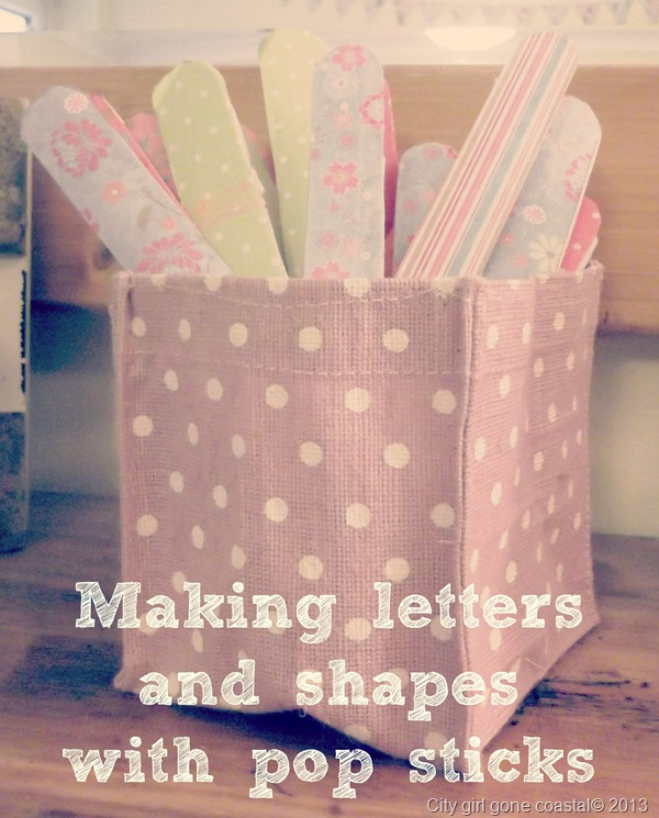 making letters and shapes with pop sticks