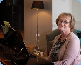 Sandi Crawford playing the grand piano. Photo courtesy of Dennis Lyons.
