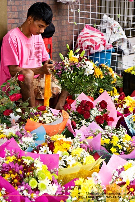 A Vendor Preparing a Bouquet at Dangwa Flower Market in Manila