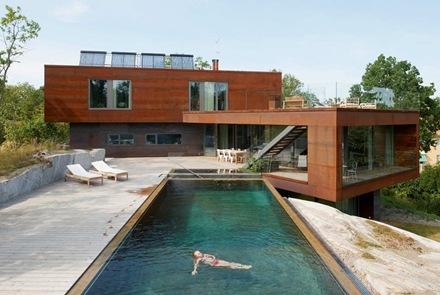 Villa midgard con modernas fachadas de acero en estocolmo for Case moderne classiche