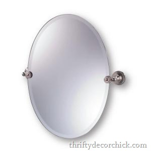 oval mirror with pivot brackets