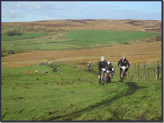 Cyclists ascending towards Shackleton Knoll