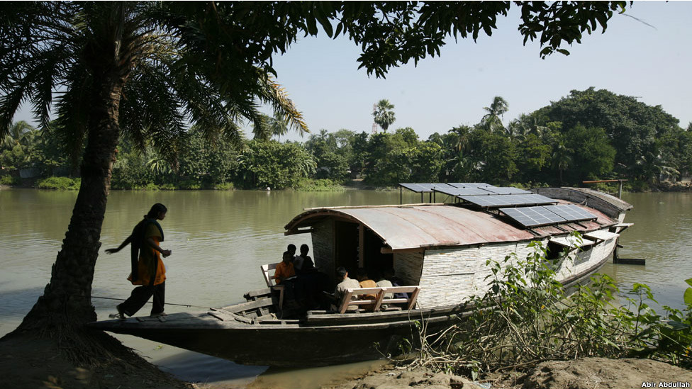 A child boards a floating school