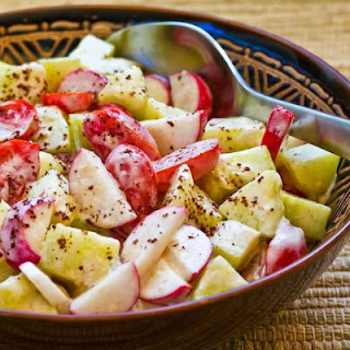 Tomato, Cucumber, and Radish Salad with Yogurt and Tahini Dressing.