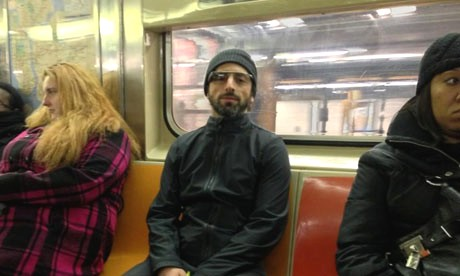 Sergey Brin riding NY transit wearing Google glasses