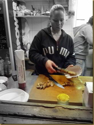 Currywurst being created. Image slightly fuzzy due to camera being held by inebriated man