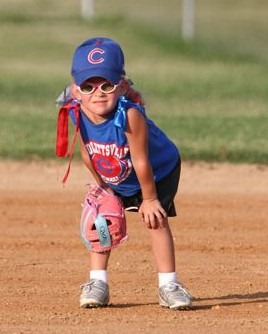 Tball girl with glasses and pink glove web