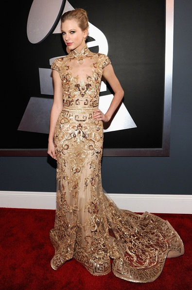 Taylor Swift arrives at the 54th Annual GRAMMY Awards