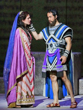 IN PERFORMANCE: mezzo-soprano Ola Rafało as Fenena (left) and tenor Brian Arreola as Ismaele (right) in Opera Carolina's production of Verdi's NABUCCO [Photo by jonsilla.com, © 2014 by Opera Carolina]