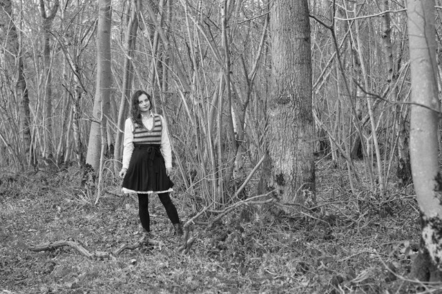 girl in the woods with a lace skirt