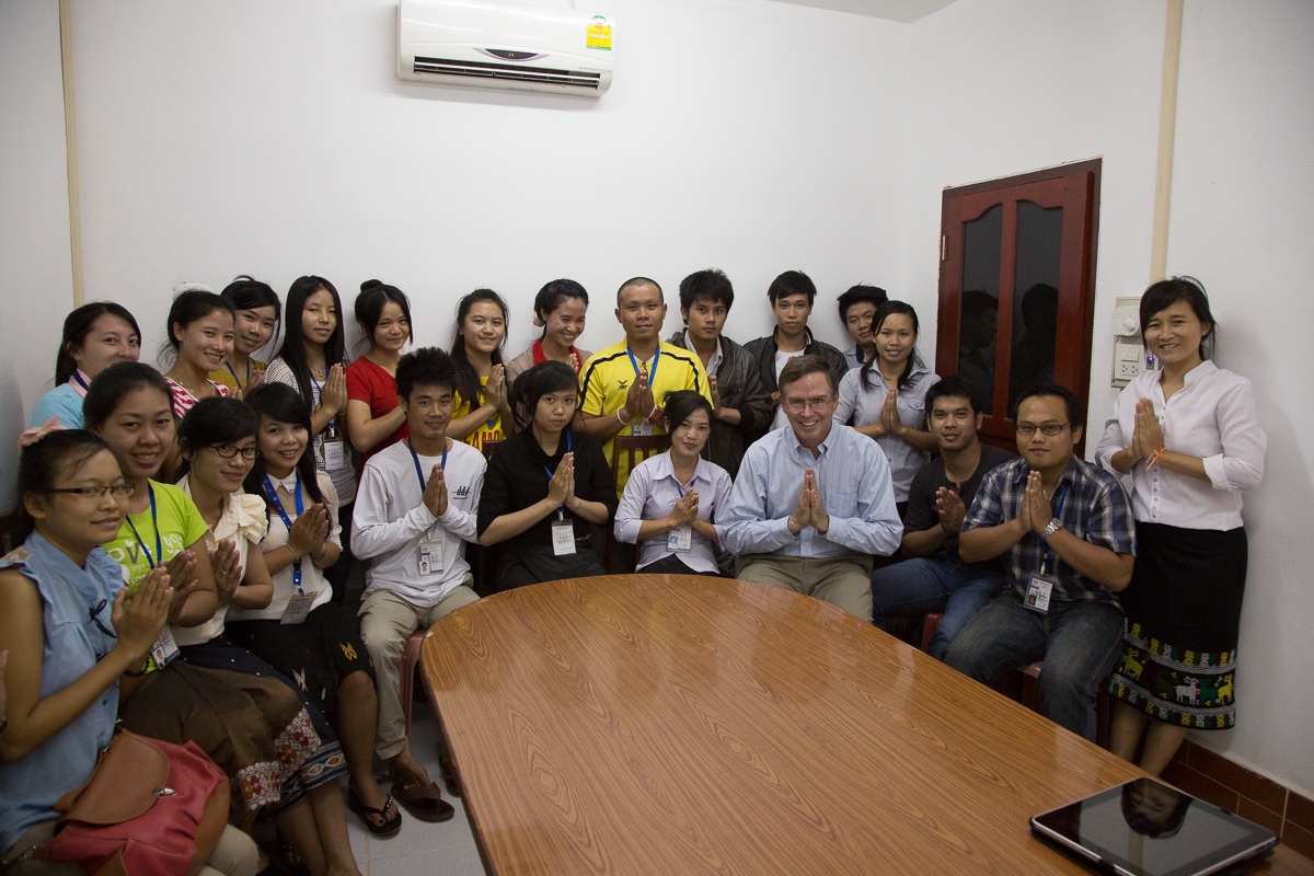 "Twenty DDD staff and Jim Fruchterman, making the ""wai"" greeting gesture (hands held together)"