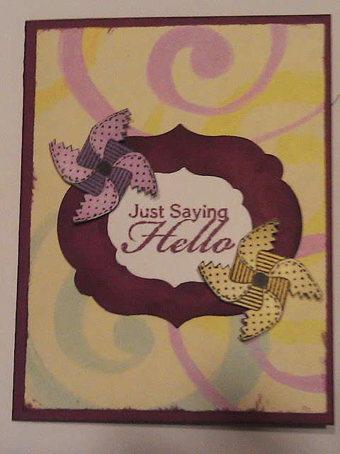 Greeting card with fussy cut pinwheels and just saying hello stamping