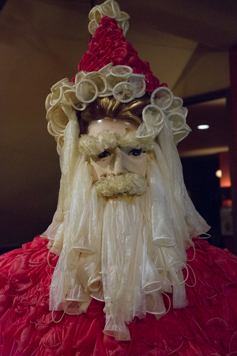 Santa Claus close-up, showing that that the mannequin's beard, hair and clothes are made with colored condoms.