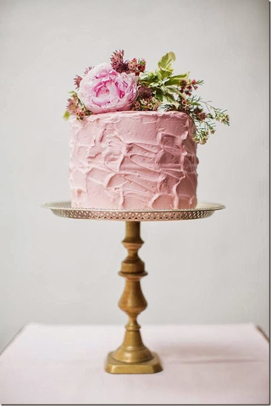 that yummy looking pink cake pops beautifully against that brass cake stand