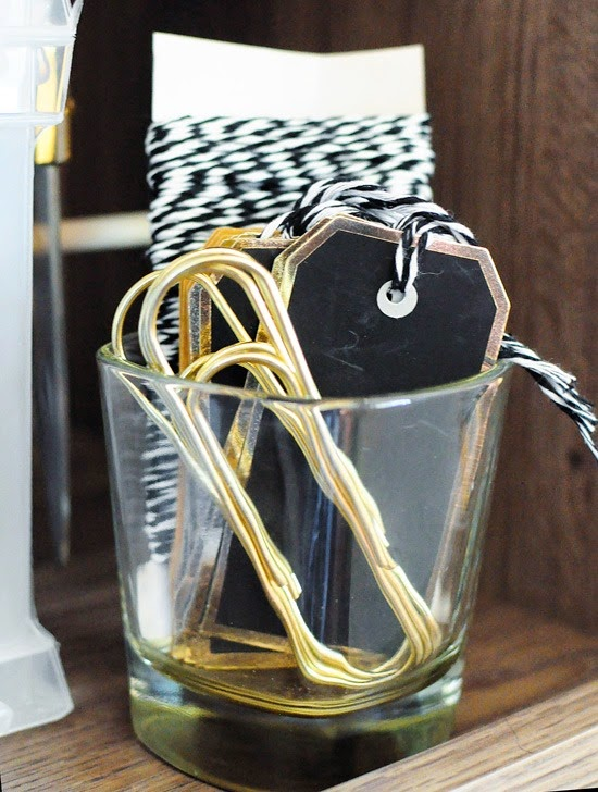 Revamp a glass with a nice silhouette into a catch all for jewelry or office supplies.