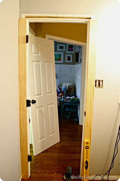 Replace thin door trim with chunky wood