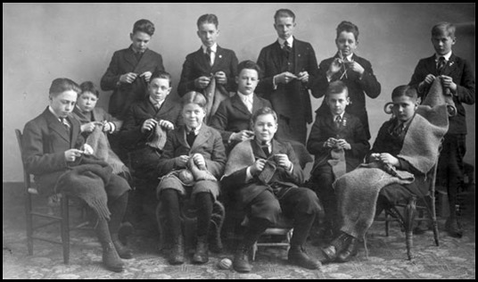 Photo of a group of boys from Cooperstown High School, who are knitting on behalf of the Red Cross, for the soldiers on the frontlines in WWl (1918) Photo | Pinterest