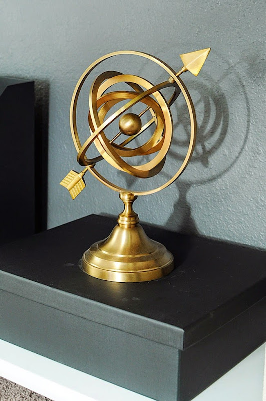 Armillary spheres add a bold, classic and timeless look to any space. This one from World Market is a beautiful accessory in Monica Wants It's home office makeover.