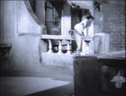 Lalita's cousin climbing into Shekhar's house