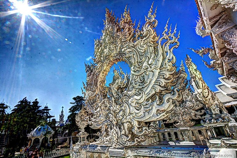 White temple sculpture sun Chiang Rai Thailand