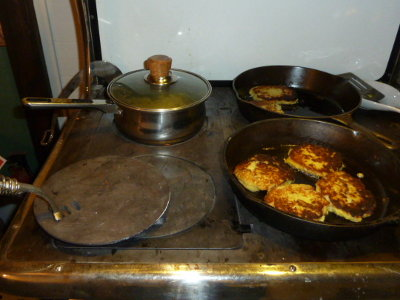 Cooking potato pancakes & applesauce on the wood cookstove.