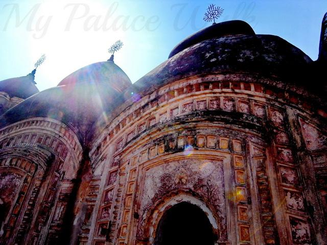 Sun shines on three domes at Rajbari Temples Kalna West Bengal