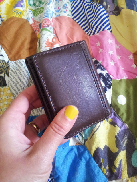 My brown leather wallet bought as a small treat. | 3 things to help you stick to your savings goal.