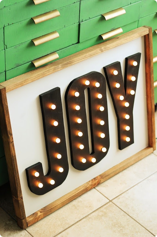joy marquee sign with Christmas lights