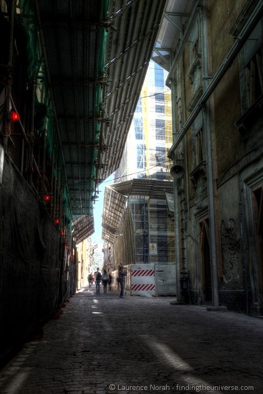 Aquila ruined streets man filming