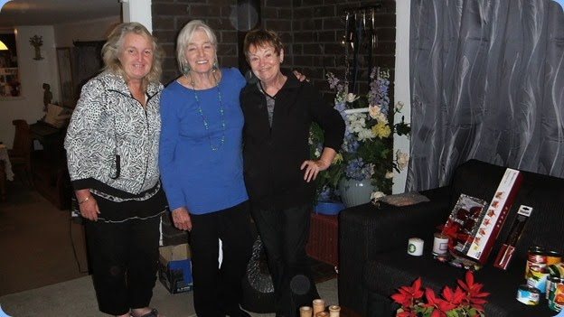 Desiree Barrows, Delysie Whorwood and Diane Lyons celebrating a job well done packing the Xmas Hampers for our December Club Night. They packed the goodies after the Coffee Day finished. Photo courtesy of Dennis Lyons.