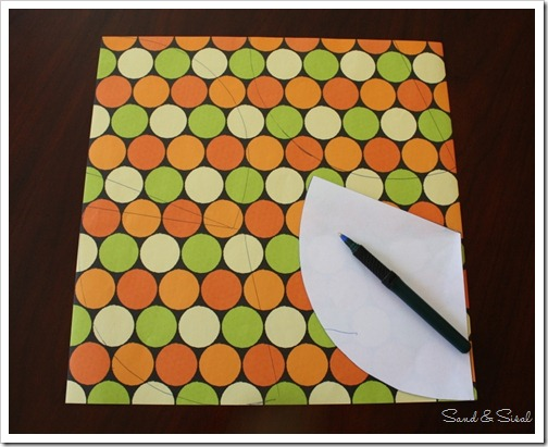 Trace cone template onto paper