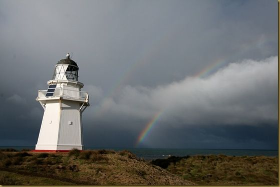 Waipapa Lighthouse double rainbow stormy sky